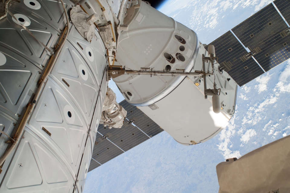 This April 22, 2014 file photo provided by NASA shows a photo of the SpaceX Dragon spacecraft docked to the International Space Station and was photographed by one of two spacewalking astronauts. (AP Photo/NASA, File)
