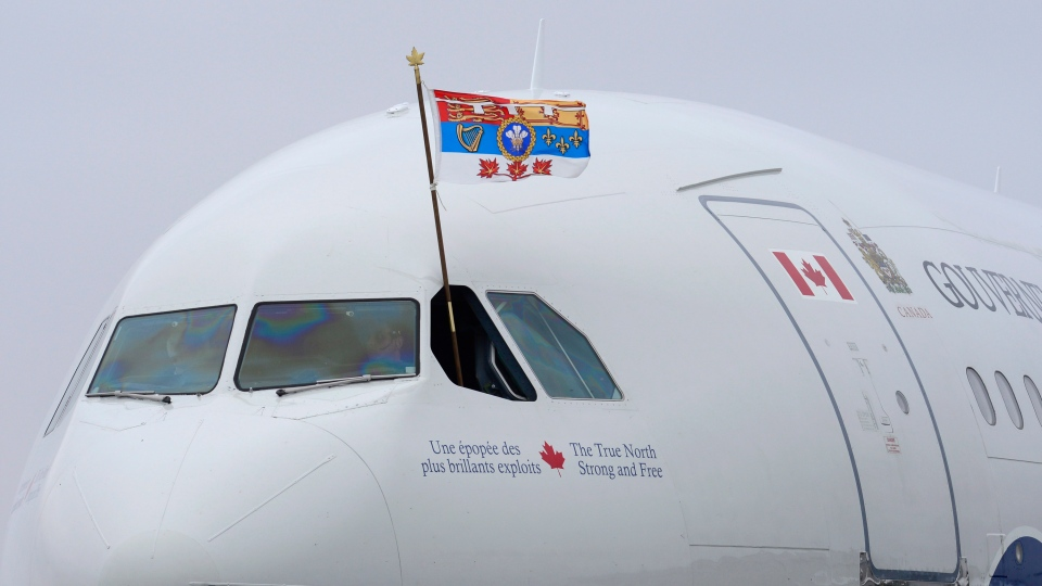 A pilot flies The Prince of Wales' Canadian standard as Charles and the Duchess of Cornwall land in Halifax on Sunday, May 18, 2014. (Paul Chiasson / THE CANADIAN PRESS)