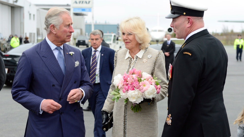 Prince Charles and Camilla the Duchess of Cornwall are greeted by officials in Halifax Sunday, May 18, 2014. (Paul Chiasson / THE CANADIAN PRESS)