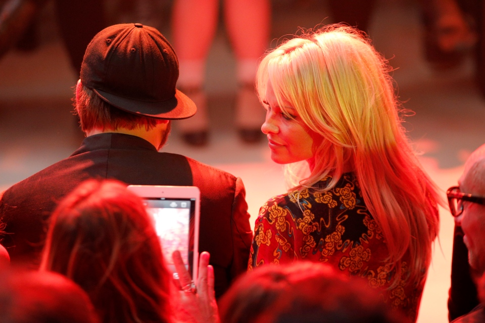 Pamela Anderson at a Vivienne Westwood fashion show on Saturday, Sept. 28, 2013 in Paris. (AP / Christophe Ena)