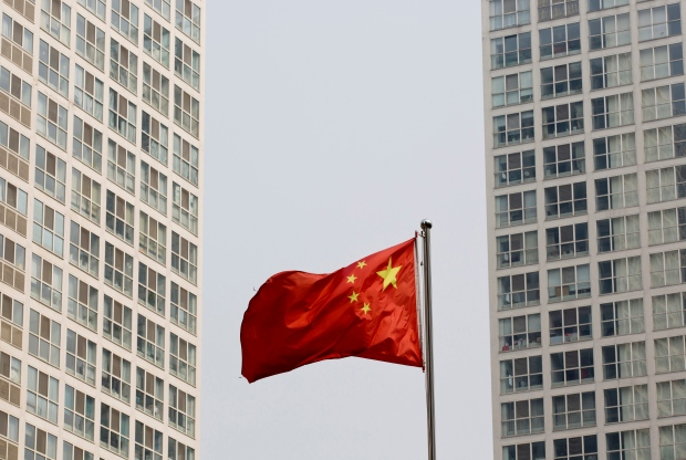 Chinese flag near residential building in Beijing