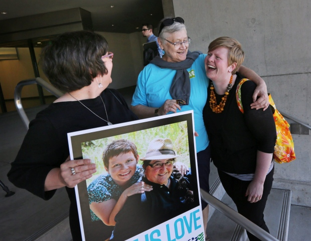 Same-sex couples at the courthouse in Eugene, Ore.