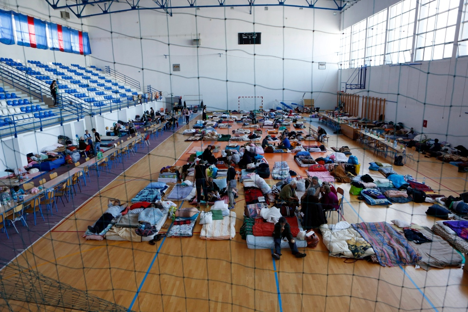 Bosnian people evacuated from their flooded homes take shelter in a sports centre in the northern Bosnian town of Odzak, Monday, May 19, 2014. (AP / Amel Emric)