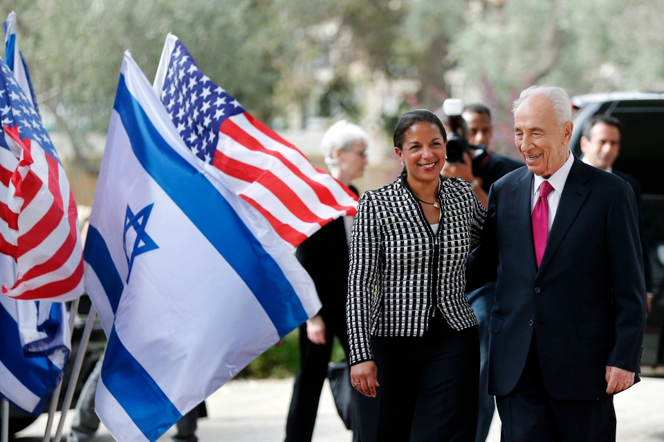 Israel's President Shimon Peres, right, welcomes U.S. National Security Adviser Susan Rice, left, before their meeting in Jerusalem, Wednesday, May 7, 2014. (AP Photo/Tsafrir Abayov)
