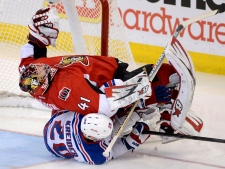 Ottawa Senators goalie Craig Anderson is taken dow