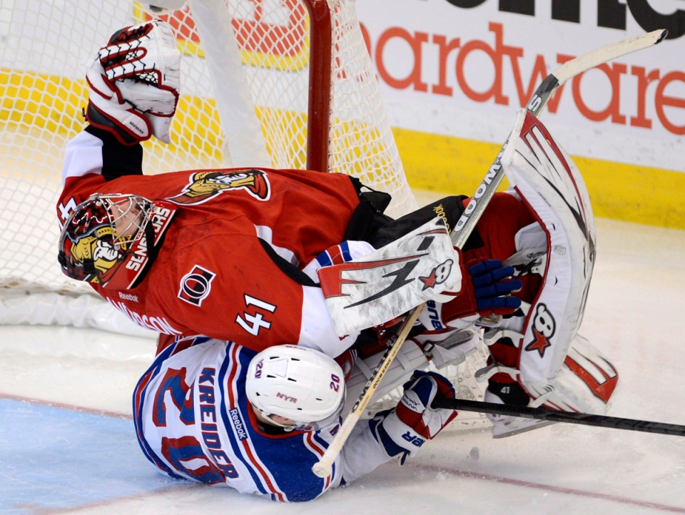 Ottawa Senators goalie Craig Anderson is taken down New York Rangers' Chris Kreider during third period NHL action in Ottawa on Thursday February 21, 2013. THE CANADIAN PRESS/Adrian Wyld