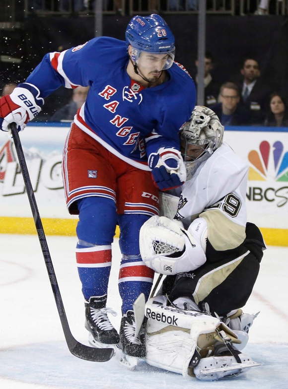 New York Rangers left wing Chris Kreider (20) collides with Pittsburgh Penguins goalie Marc-Andre Fleury (29) in the second period of Game 6 of an NHL hockey second-round hockey playoff series, Sunday, May 11, 2014, in New York. Kreider was penalized for goalie interference on the play. (AP Photo/Kathy Willens)