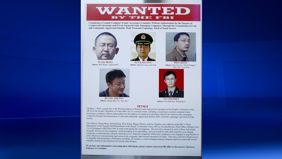 This wanted poster is displayed at the Justice Department in Washington, Monday, May 19, 2014.