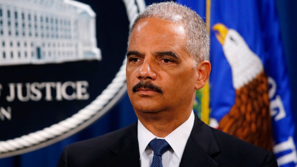 Attorney General Eric Holder listens during a news conference at the Justice Department in Washington, Monday, May 19, 2014. (AP / Charles Dharapak)