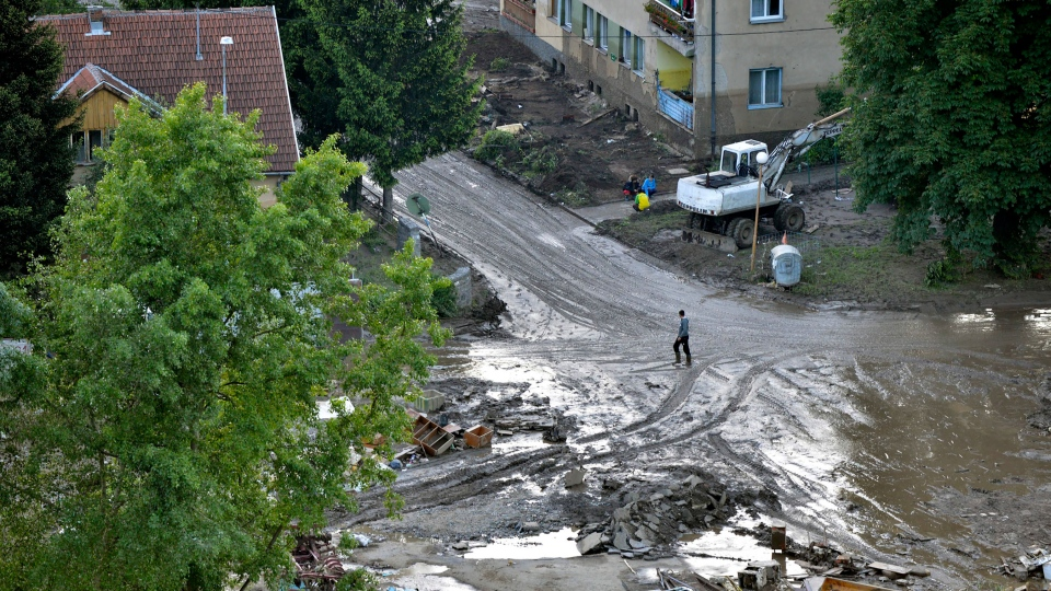 A man walks through mud after devastating floods in the town of Maglaj 140 kilometers north of Sarajevo, Bosnia-Herzegovina on Monday May 19, 2014. (AP / Sulejman Omerbasic)