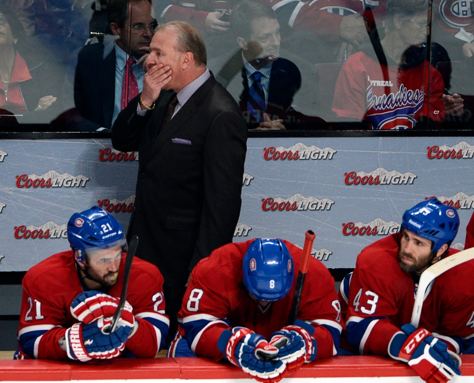 Montreal Canadiens head coach Michel Therrien and players Brian Gionta, left, Brandon Prust and Mike Weaver, right, watch the final minutes of the third period as they lose 3-1 to the New York Rangers in game two of the NHL Eastern Conference final Stanley Cup playoff action Monday, May 19, 2014 in Montreal.THE CANADIAN PRESS/Ryan Remiorz
