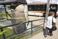 A piece of steel weighing hundreds of pounds, that was blown over 500 metres from the site of the explosion, sits embedded in a bus shelter in Toronto on Monday August 11, 2008. (Frank Gunn / THE CANADIAN PRESS)