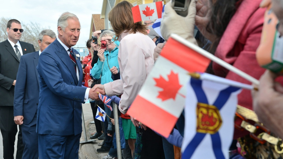 Prince Charles greets members of the crowd during welcoming ceremonies in Pictou, N.S., on Monday, May 19, 2014. (AP / The Canadian Press, Paul Chiasson)