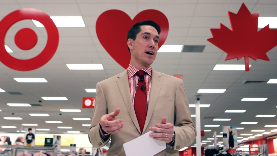 Tony Fisher, president of Target Canada, speaks to the media during a tour of the new Target store in Guelph, Ont. Target has fired Fisher, and is replacing him with a 15-year U.S. company veteran. (Dave Chidley / THE CANADIAN PRESS)