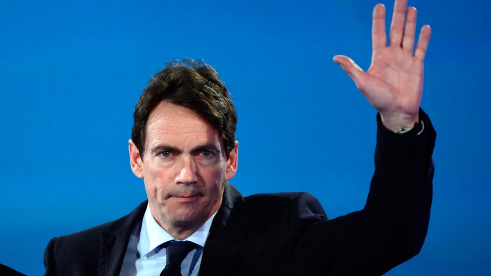PQ candidate Pierre Karl Peladeau waves on Monday April 7, 2014 in Montreal. (THE CANADIAN PRESS / Paul Chiasson)