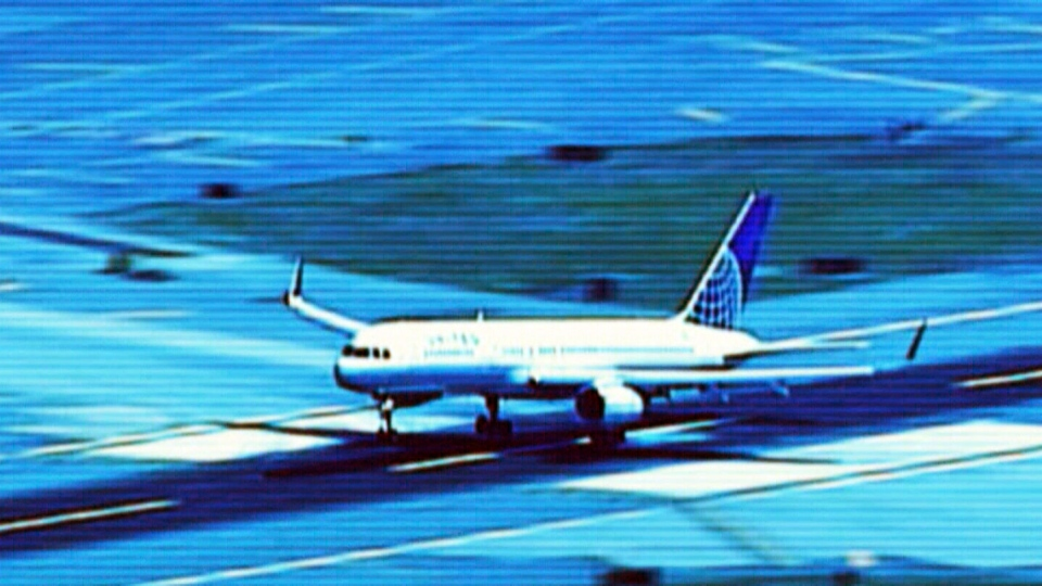 A plane taking off and another plane landing on intersecting runways at Newark Liberty Airport nearly collided last month, according to a preliminary federal report.