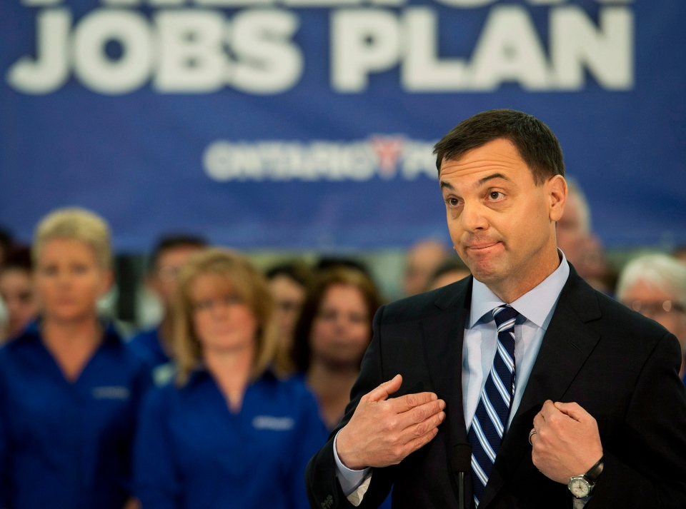 Ontario PC Leader Tim Hudak makes an announcement at a packaging plant about creating 40,000 jobs in Ontario with affordable energy during a campaign stop in Smithville, Ont., on Monday, May 12, 2014. (Nathan Denette / THE CANADIAN PRESS)