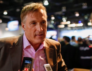 Maxime Bernier speaks to reporters at the Conservative convention in Calgary on Nov. 2, 2013. (THE CANADIAN PRESS/Jeff McIntosh)