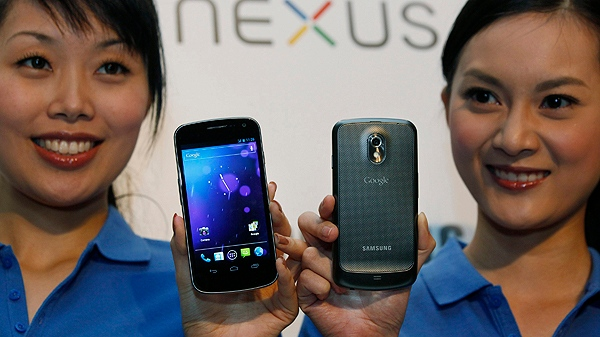 Models display the new Galaxy Nexus smartphone during a news conference in Hong Kong Wednesday, Oct. 19, 2011. (AP Photo/Kin Cheung)