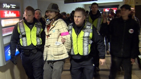 An Occupy Vancouver protester is led away by police. Nov. 18, 2011. (CTV)