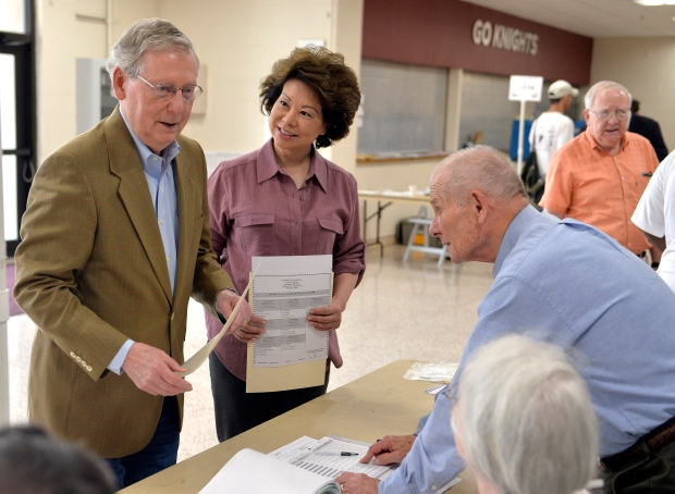 U.S. Senator Mitch McConnell with poll workers