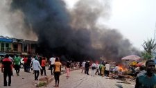 At least 118 dead in twin bombings in Nigeria
