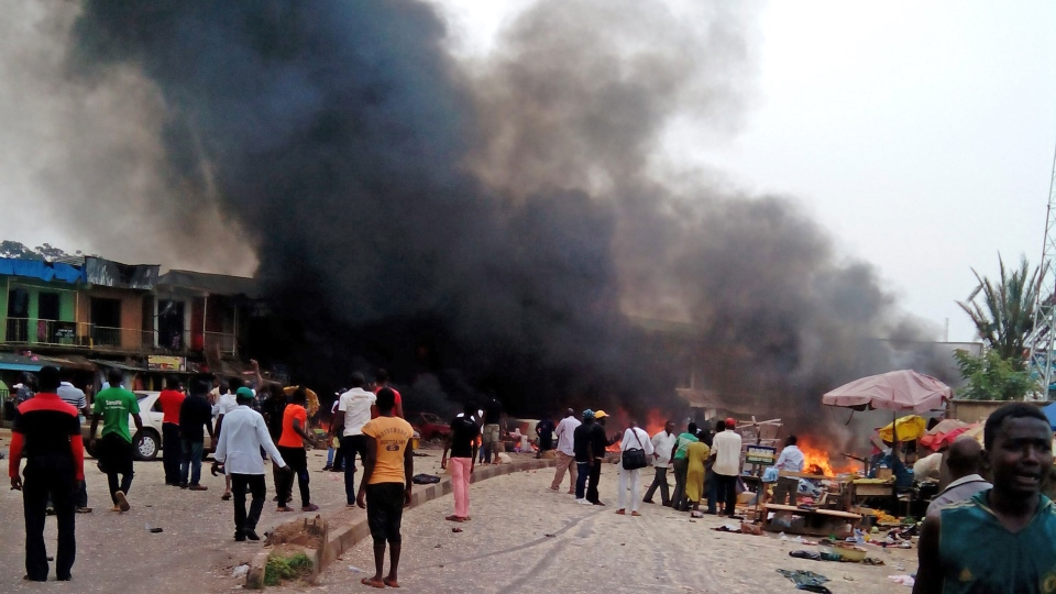 Smoke rises after a bomb blast at a bus terminal in Jos, Nigeria, Tuesday, May 20, 2014. (AP / Stefanos Foundation)