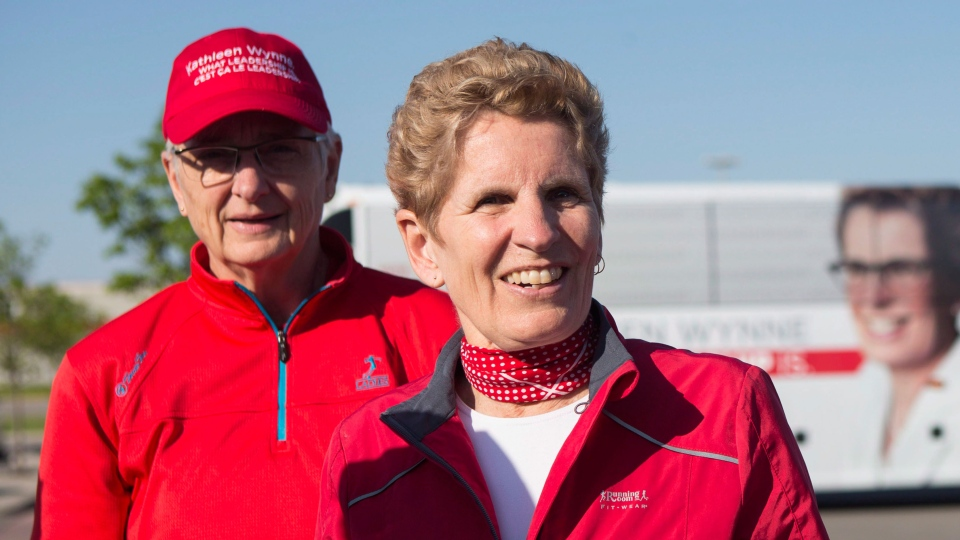 Ontario Liberal Leader Kathleen Wynne is joined by her partner Jane Rounthwaite (left) as they prepare to take part in the Inspirational Steps run in support of the Guru Gobind Singh Children's Foundation, in Mississauga on Monday May 19, 2014. (Chris Young / THE CANADIAN PRESS)