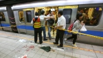 Officials block parts of the scene of a knife attack on a subway platform, in Taipei, Taiwan, Wednesday, May 21, 2014. (AP Photo)