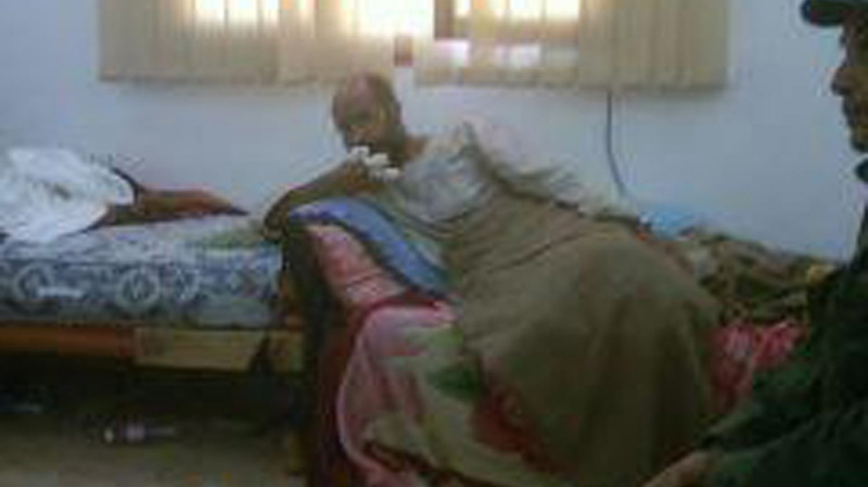 This unverified image from Libyan television and made available by the Libyan Outreach group via Facebook, Saturday, Nov. 19, 2011, purportedly shows Seif al-Islam Gadhafi in custody in an undisclosed location. (AP Photo/Libyan TV via Libyan Outreach)
