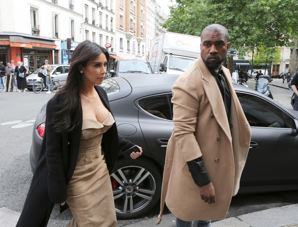 Kim Kardashian and U.S. rap singer Kanye West arrive at a luxury shop in Paris, Wednesday, May 21, 2014. (AP / Jacques Brinon)