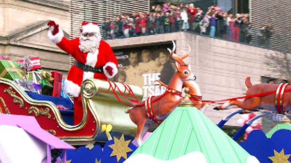 Santa Claus waves to the crowds at the 107th Santa Claus Parade in Toronto on Sunday, Nov. 20, 2011.