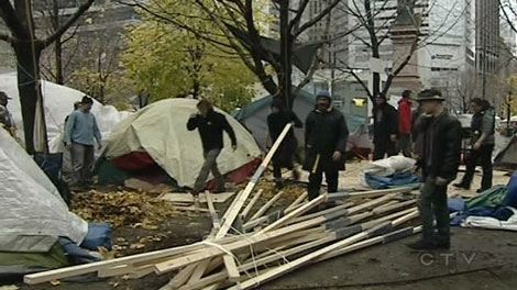 All the wooden structures have been dismantled at Occupy Montreal in Victoria Square.
