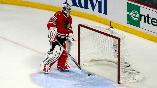 Blackhawks Corey Crawford sweeps the puck out