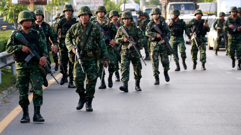 Thai soldiers move in to a pro-government demonstration site after the military seized power Thursday, May 22, 2014, on the outskirts of Bangkok, Thailand. (AP / Wason Wanichakorn)