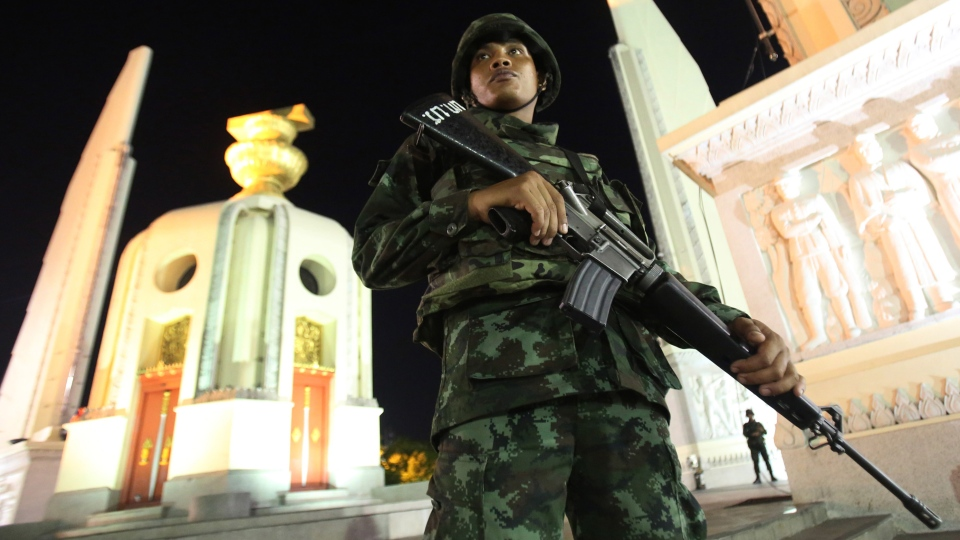A Thai soldier stands guard in front of the Democracy Monument after the coup Thursday, May 22, 2014 in Bangkok, Thailand. (AP / Sakchai Lalit)