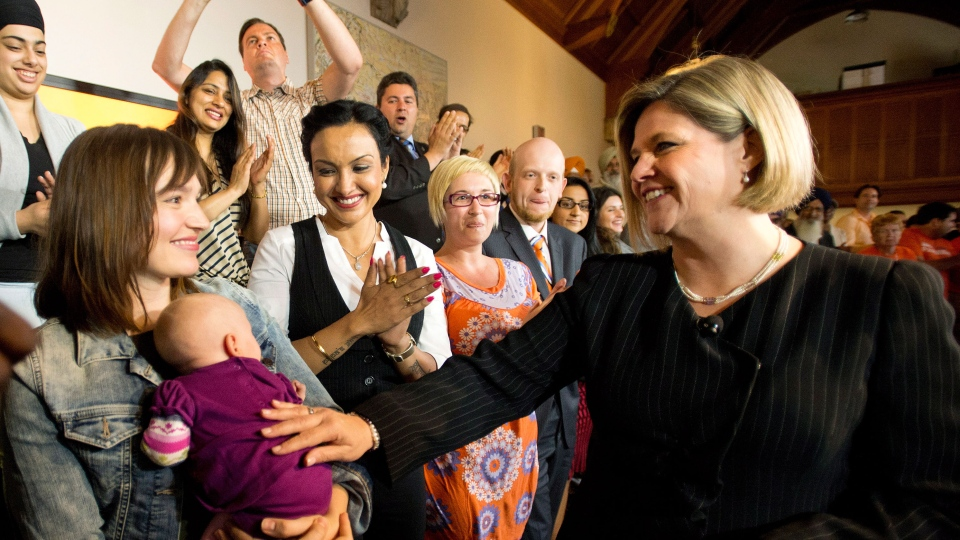 Ontario NDP leader Andrea Horwath, right, greets supporters before she delivers her campaign platform during a campaign stop in Toronto on Thursday, May 22, 2014. (Nathan Denette / THE CANADIAN PRESS)