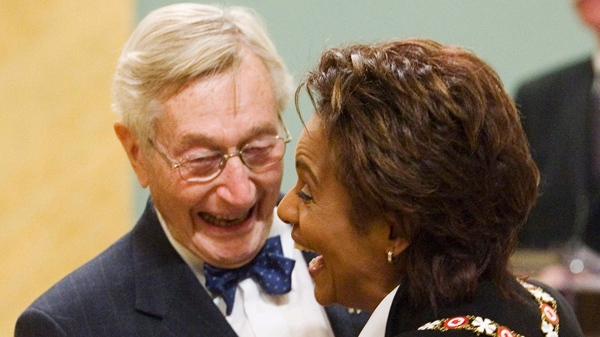 John Neville shares a laugh as he is invested as Member to the Order of Canada by Governor General Michaelle Jean at a ceremony in Ottawa, Friday May 4, 2007. (CP / Fred Charrand)