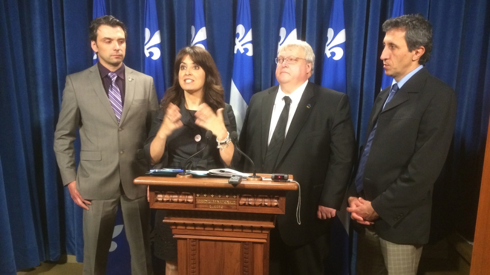 Former PQ social services minister Veronique Hivon and current Health Minister Gaetan Barrette, flanked by the CAQ's Sebastien Schneeberger and Quebec Solidaire's Amir Khadir on May 22, 2014 (Frederic Bissonnette/CTV Montreal)