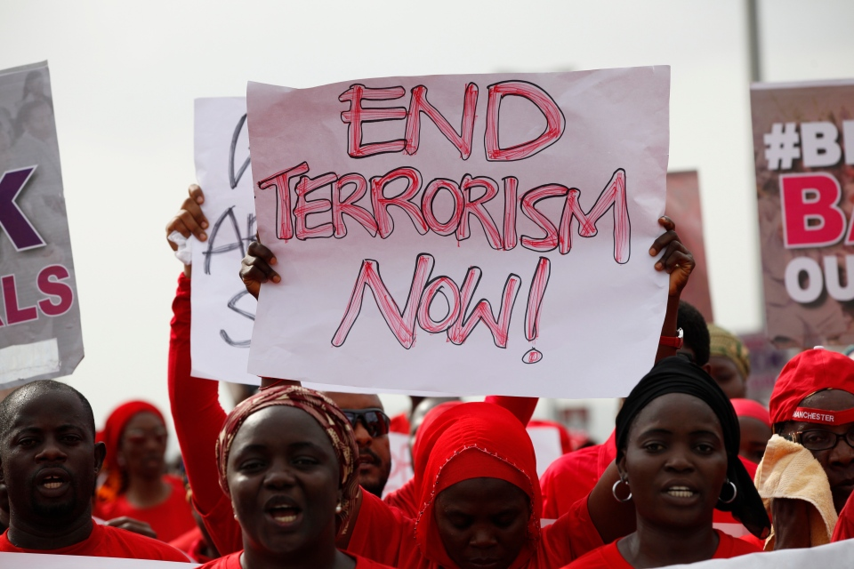 People attend a demonstration calling on the government to rescue the kidnapped girls of the government secondary school in Chibok, in Abuja, Nigeria, Thursday, May 22, 2014. (AP / Sunday Alamba)