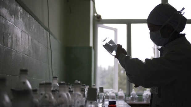 A nurse prepares IV drips for AIDS patients at a hospital in Chengdu, China, on Nov. 15, 2011