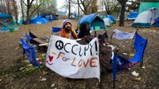 Occupy Toronto protesters hold their ground and space after sleeping outside in St. James Park in Toronto on Monday, Nov. 21, 2011. (Nathan Denette / THE CANADIAN PRESS)