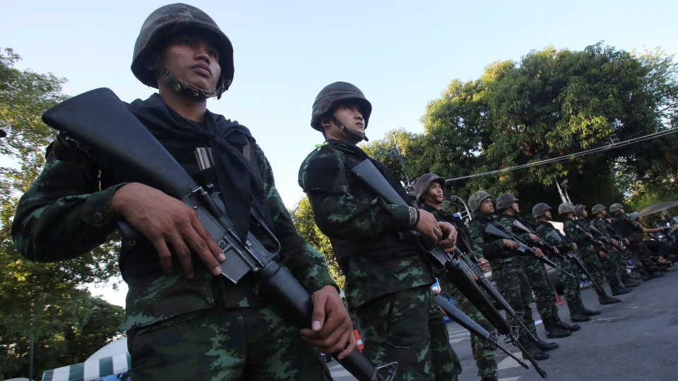 Thai soldiers stand guard near Government House in Bangkok, Thailand, Friday, May 23, 2014, a day after their coup. (AP / Sakchai Lalit)
