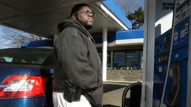 Man wears a gun while pumping gas in Detroit