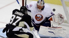 Pittsburgh Penguins' Sidney Crosby, 87, scores a first-period goal over New York Islanders goalie Anders Nilsson during an NHL hockey game in Pittsburgh on Monday, Nov. 21, 2011. (AP / Gene J. Puskar)