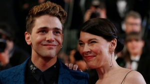 Director Xavier Dolan and actress Anne Dorval arrive for the screening of 'Mommy' at the 67th international film festival, Cannes, southern France, Thursday, May 22, 2014. (AP Photo/Alastair Grant)