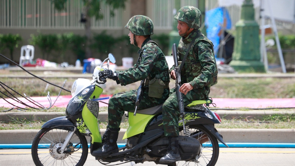 Thai soldiers patrol on a motorcycle during a cleanup operation at a pro-government demonstration site on the outskirts of Bangkok, Thailand Friday, May 23, 2014. (AP / Wason Wanichakorn)
