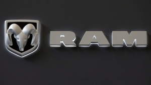 In this Feb. 14, 2013 photo, the Dodge Ram truck logo appears on a sign at the 2013 Pittsburgh Auto Show in Pittsburgh. (AP / Gene J. Puskar)