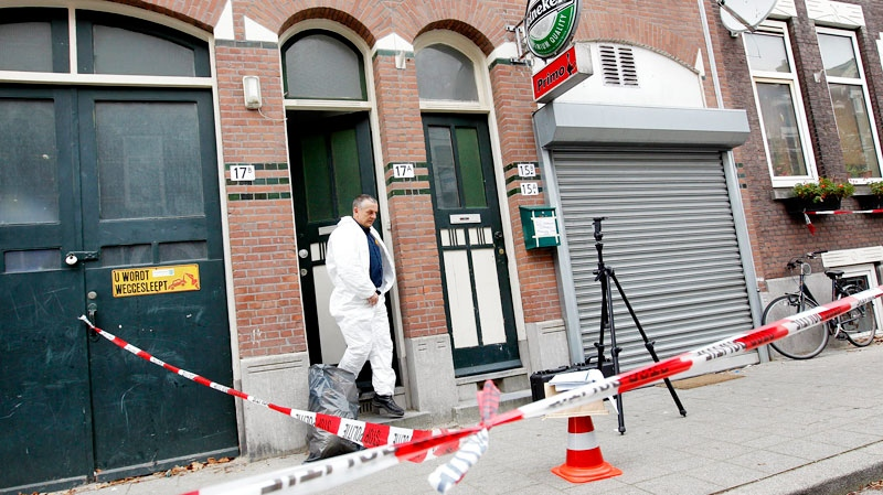 A forensic expert leaves a house where Seattle Mariners outfielder Greg Halman was found bleeding from a stab wound in the Jan Sonje street in Rotterdam, Netherlands, Monday, Nov. 21, 2011. (AP / Bas Czerwinski)