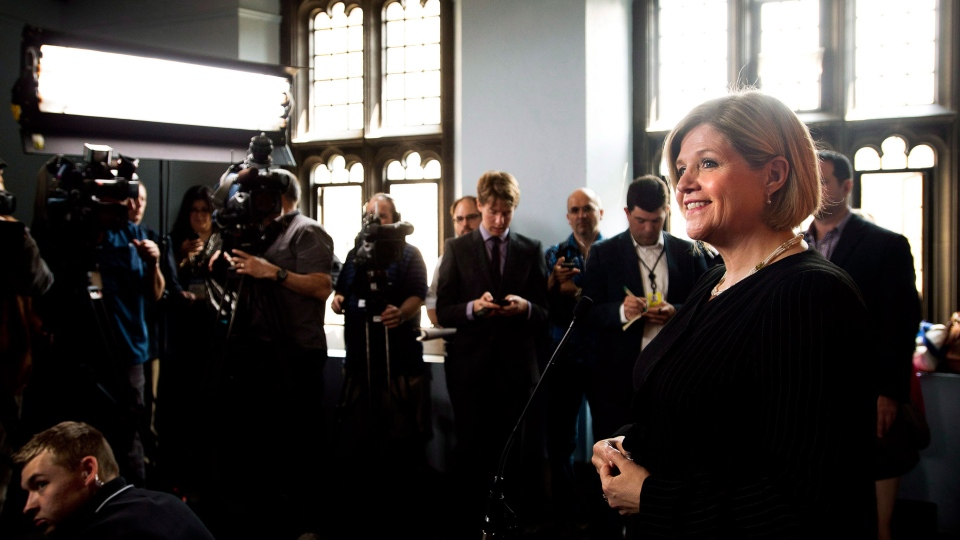 Ontario NDP leader Andrea Horwath takes questions from the media after she delivers her campaign platform during a campaign stop in Toronto on Thursday, May 22, 2014. (Nathan Denette / THE CANADIAN PRESS)